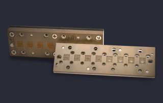 Eight site in line cartridge carrier and assembled cartridge socket