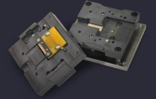 Custom heatsink in PCB module socket contacts top and bottom of UUT