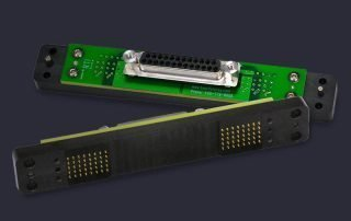 Pogo pin block with mounted PCB and mating DB25 connector